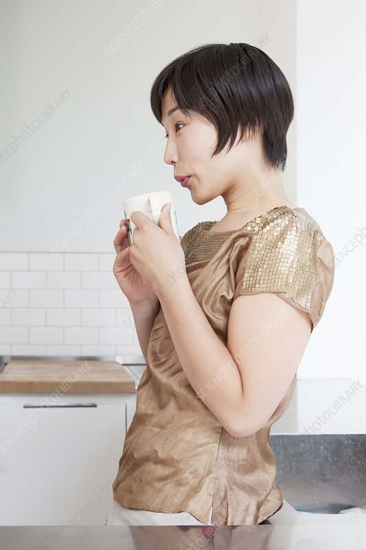 Woman cooling off coffee