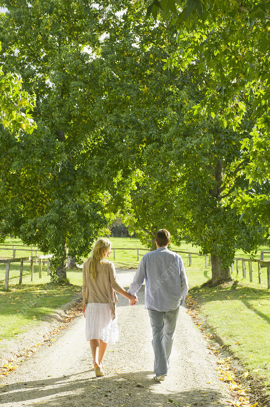 Couple walking on gravel path