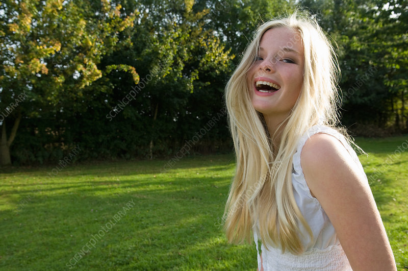 Teenage girl laughing outdoors