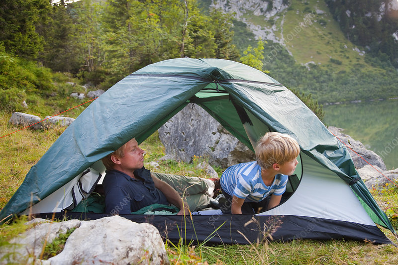 Father and son relaxing in tent