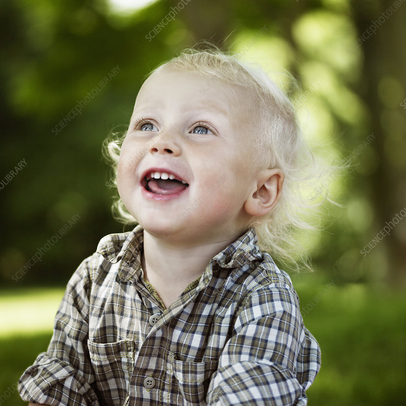 Close up of boy laughing outdoors