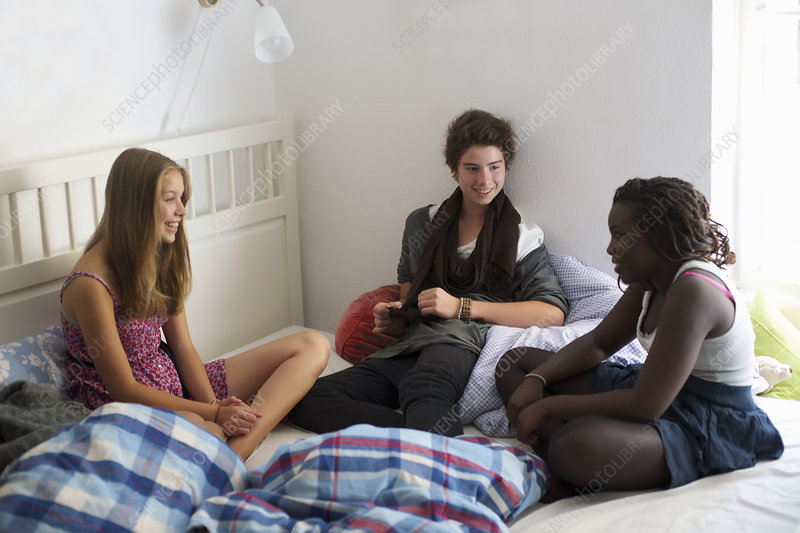 Teenagers relaxing on bed