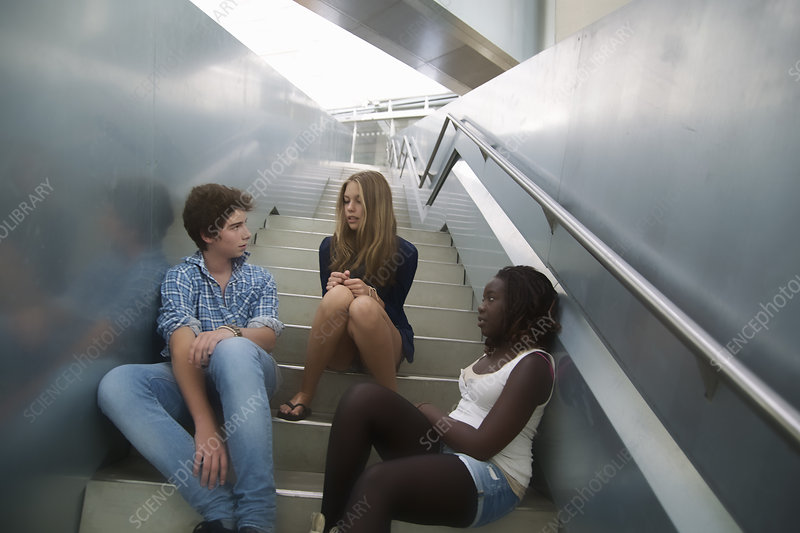 Teenagers relaxing on steps