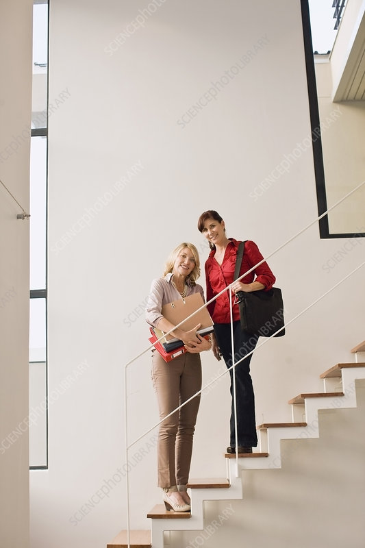 Businesswomen standing on steps