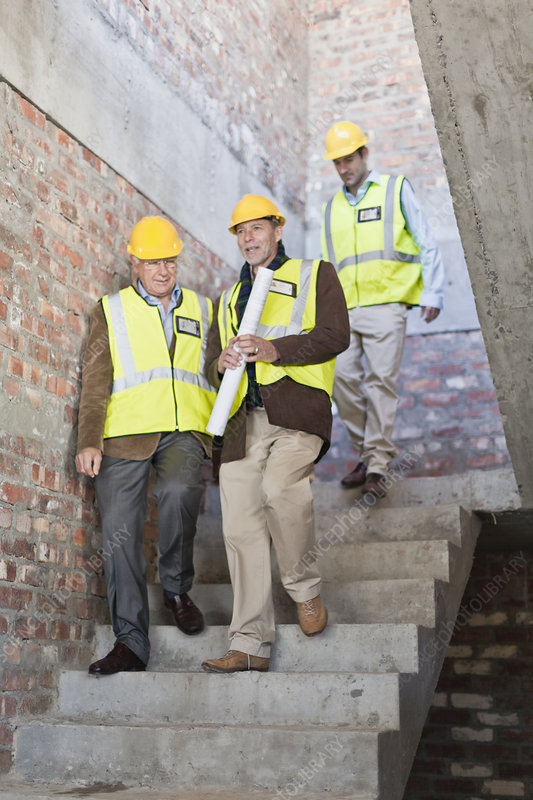 Construction workers walking on steps