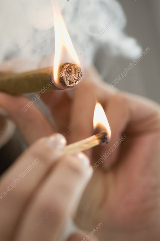 Close up of woman lighting cigarette