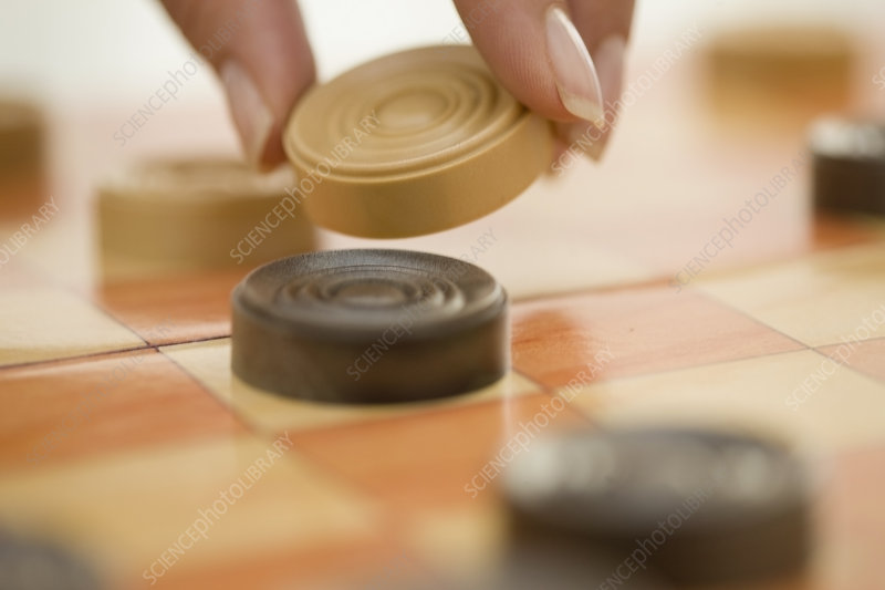 Close up of woman playing checkers