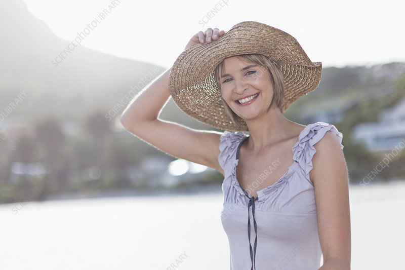 Woman wearing straw hat on beach
