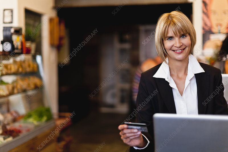 Businesswoman shopping online in cafe