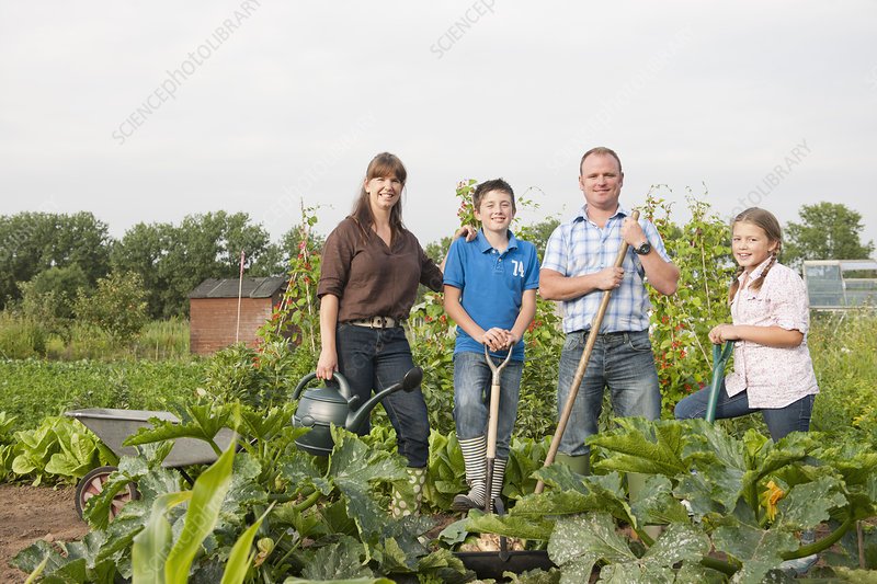 Family standing together in garden