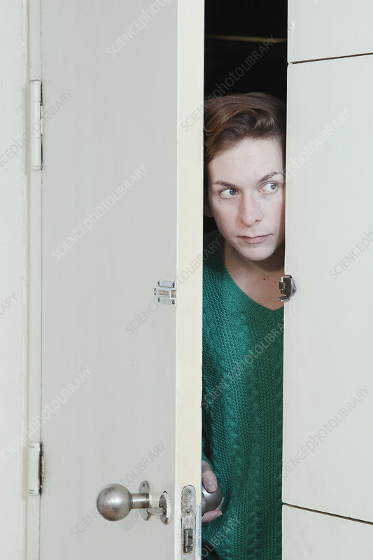 Man peeking through doorway