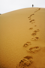Footsteps in sand dune