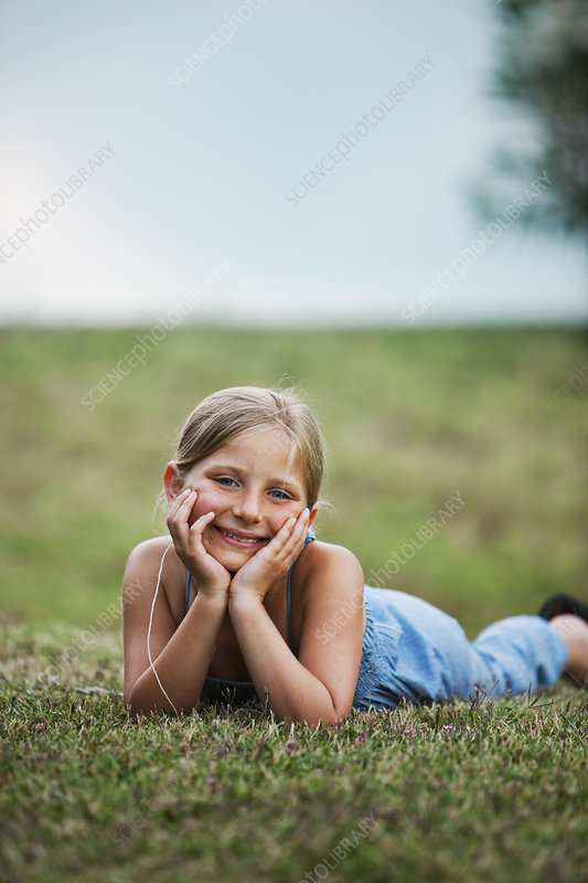 Smiling girl laying in grass