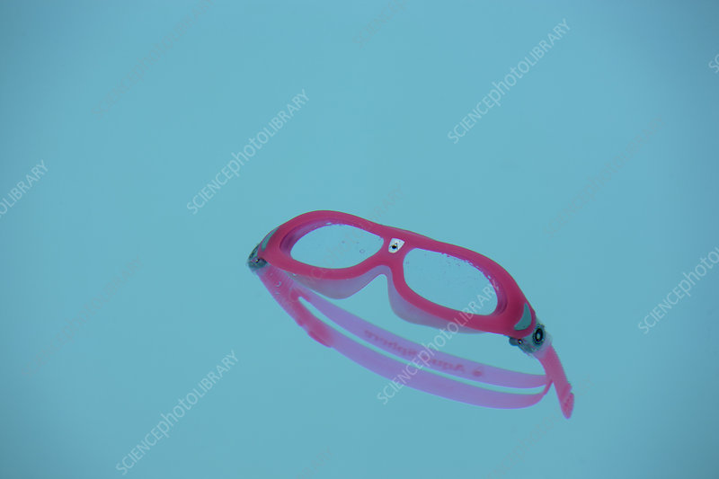 Goggles floating in swimming pool