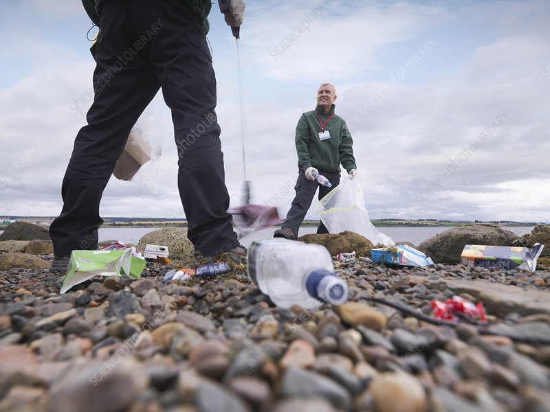 Environmentalist cleaning up beach