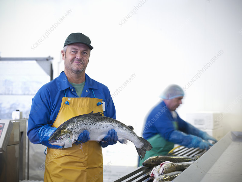 Fishmonger holding catch of the day