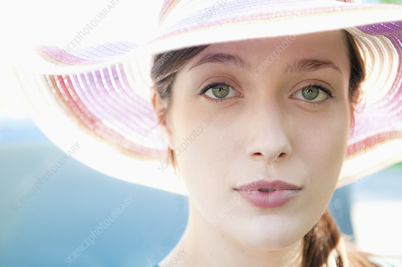 Close up of woman wearing colorful hat