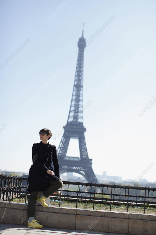 Woman sitting in front of Eiffel Tower