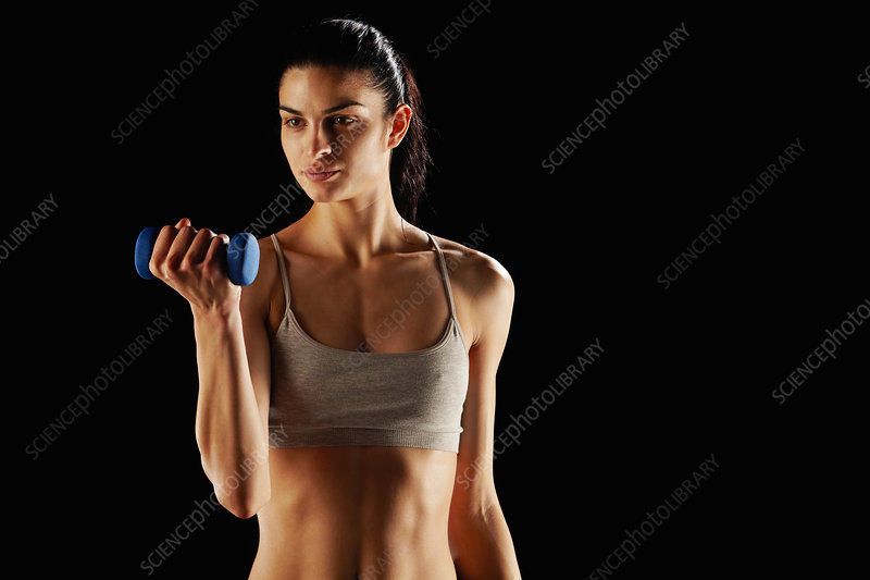 Woman lifting weights during workout