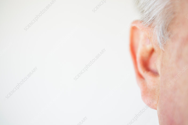 Close up of older person's ear