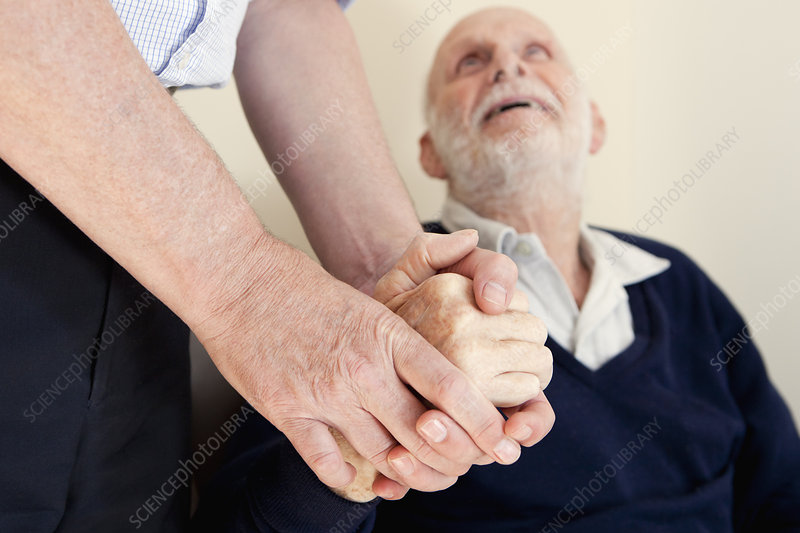 Son patting father's hand