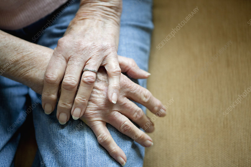 Close up of older woman's folded hands