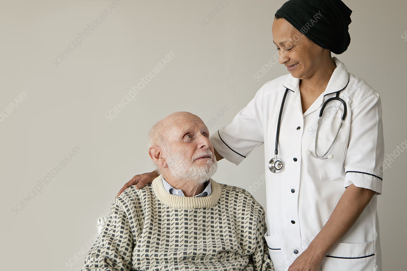 Caretaker smiling with older man