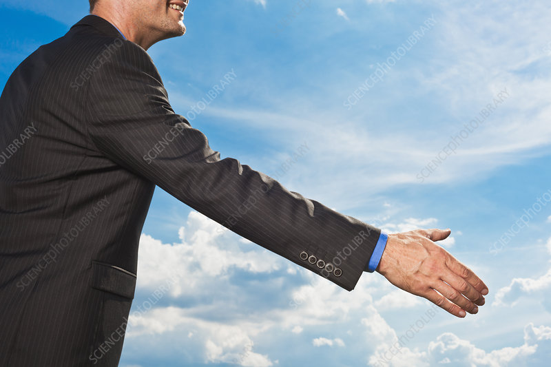 Businessman holding out hand to shake
