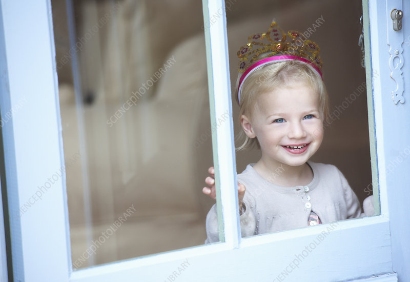 Smiling toddler girl wearing tiara