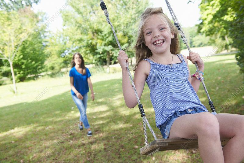 Girl playing on swing in backyard - Stock Image - F005 ...