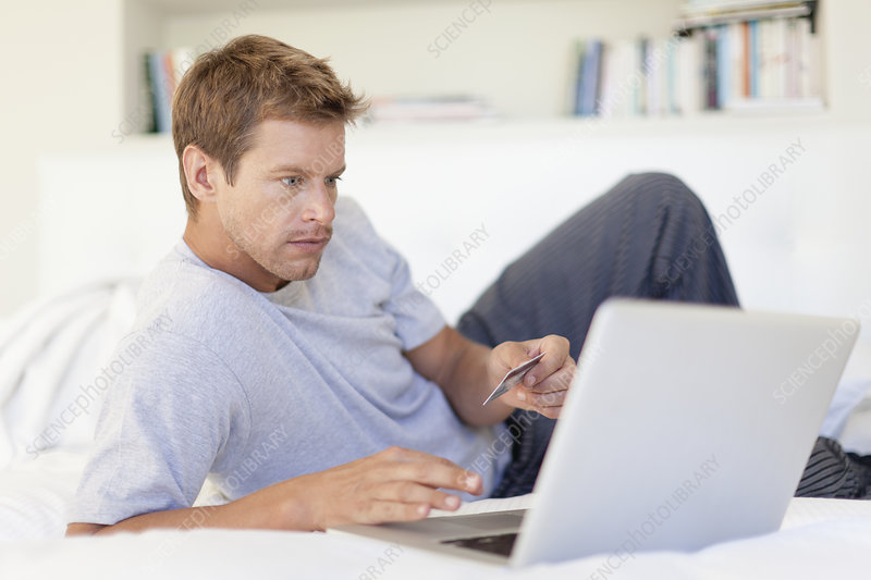 Man shopping online with laptop