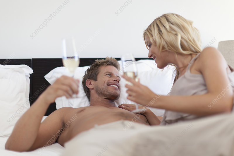 Smiling couple toasting each other