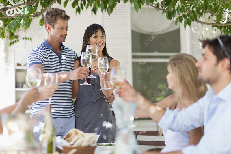 Friends toasting each other outdoors