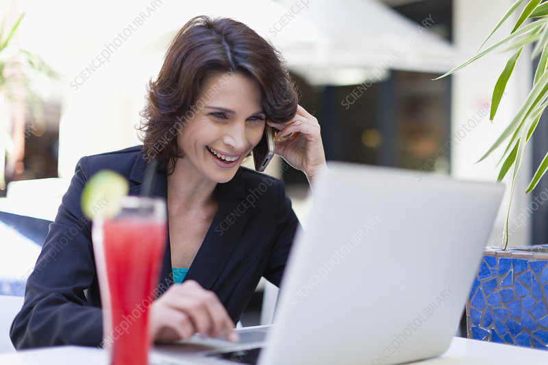 Businesswoman working in cafe