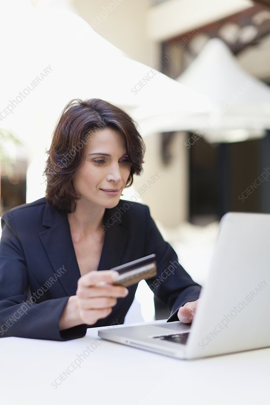 Businesswoman shopping online outdoors