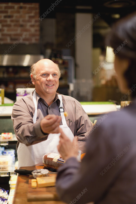 Man with free samples in grocery store