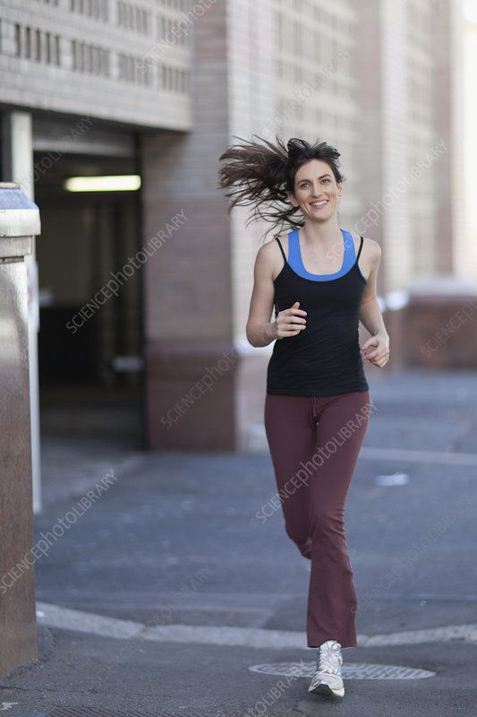 Woman running on city street