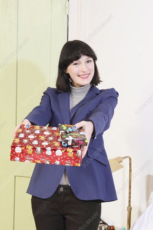 Woman offering Christmas presents