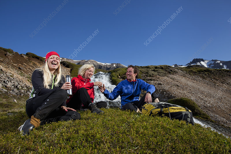 Hikers resting on patch of grass