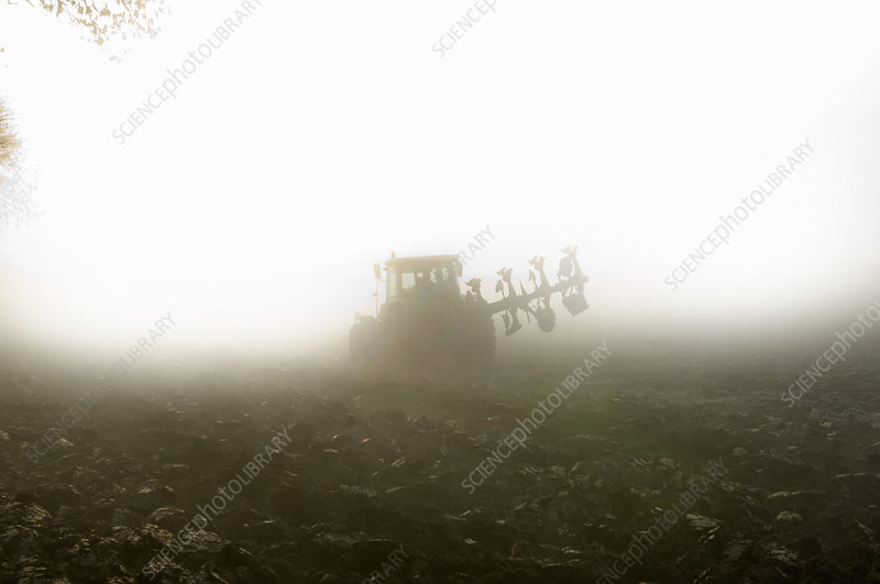 Tractor driving through fog