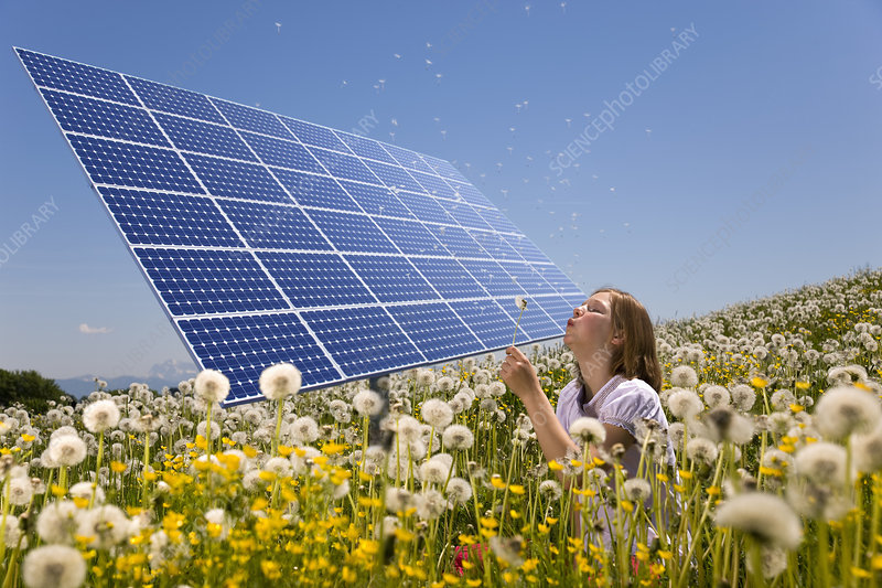Girl in field with solar panels