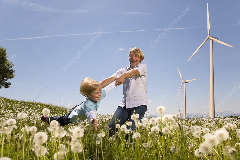 Father and son with wind turbines