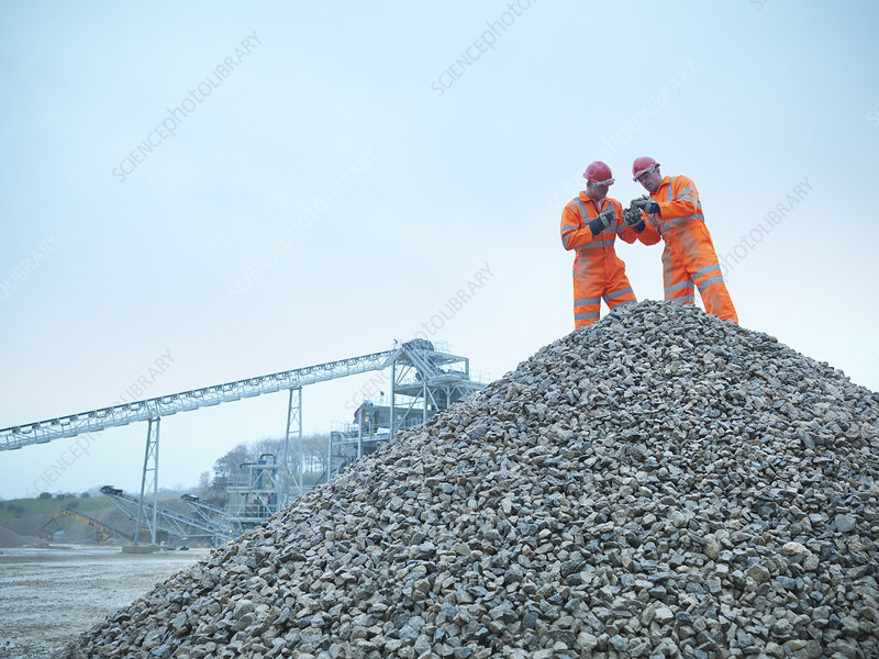 Workers inspecting quarry rocks