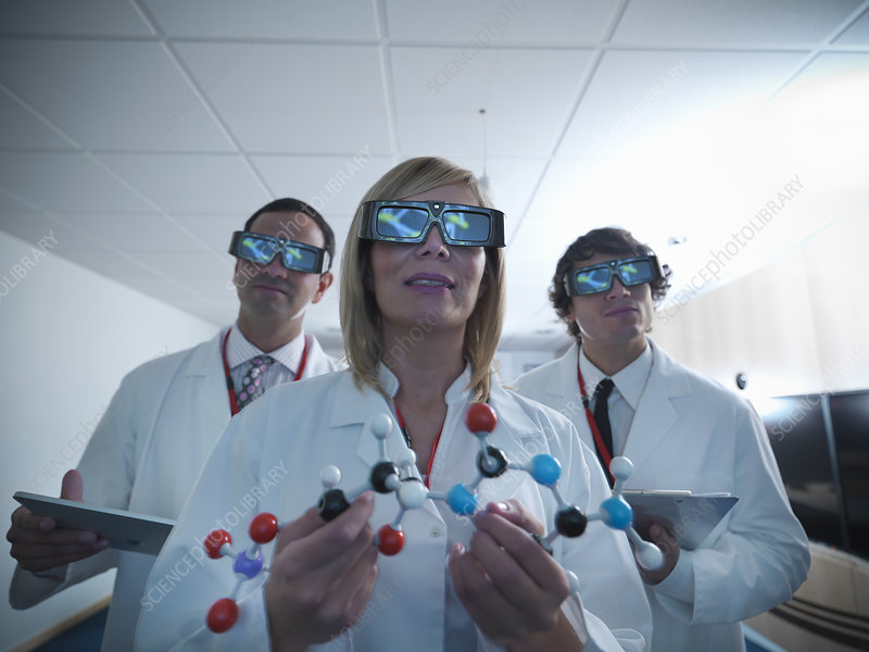 Scientists wearing 3D glasses in lab