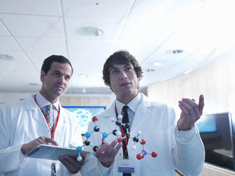 Scientists using molecular models in lab