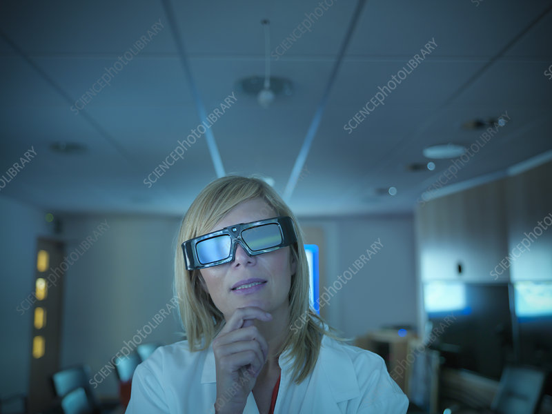 Scientist wearing 3D glasses in lab
