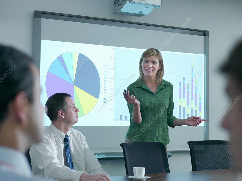 Businesswoman with projection in meeting