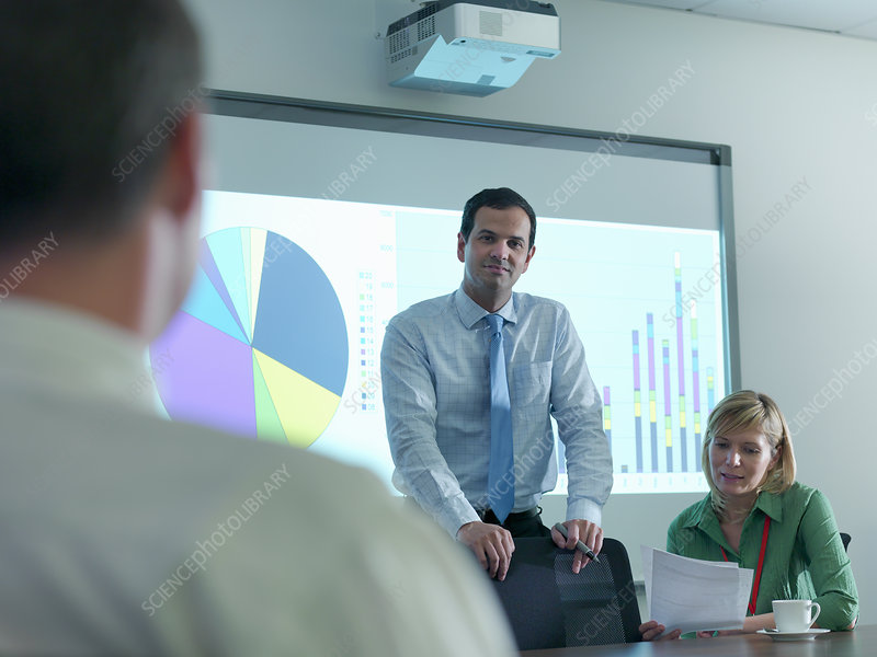 Businessman using projection in meeting
