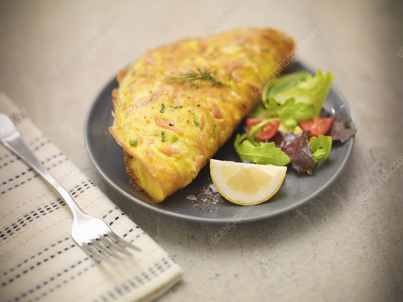 Plate of salmon omelet and salad