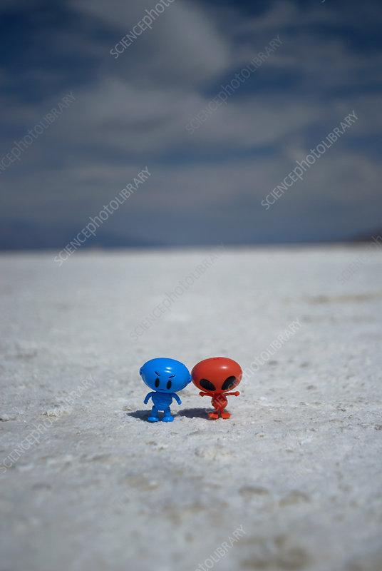 Toy alien figures on dirt path